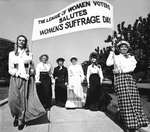 Women holding banner for 50th anniversary of women's right to vote by Frank Reed