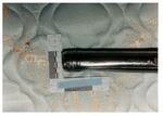 Model 19. Blow #2: metal flashlight with dent by Cuyahoga County Prosecutor's Office and Cuyahoga County Coroner's Office