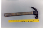 Weapon 25. Wooden handled hammer by Cuyahoga County Prosecutor's Office and Cuyahoga County Coroner's Office