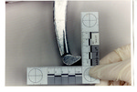 Weapon 90. H-shaped medical instrument, 8-inches, closeup of one end of the instrument