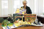 Presenter Glenda Thornton with pop-up books from her extensive collection. by Donna Stewart
