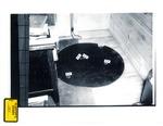 Plaintiff's Exhibit 0312:Overhead Shot of Mat Under Chair in Den